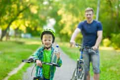 father with shared custody taking son out for a bike ride